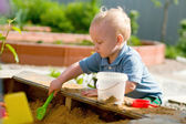 Little boy playing in the sandbox — Stock Photo