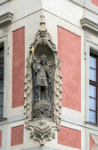 Sculpture on a building wall, Prague — Stock Photo