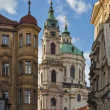 Kind on The Church of Saint Nicholas, Prague — Stock Photo