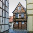 The street with half-timbered houses in Quedlinburg, Germany — Stok fotoğraf