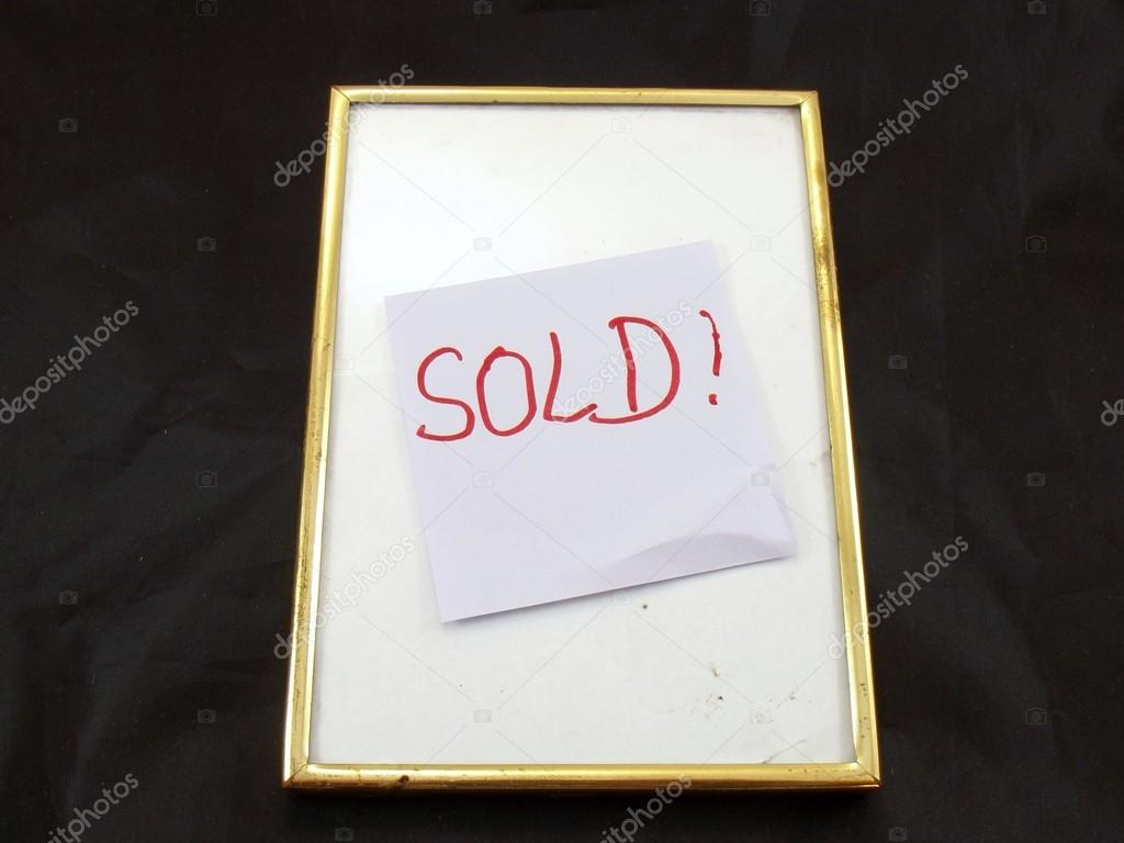 Word sold in a frame on black background — Stock Photo #13915323