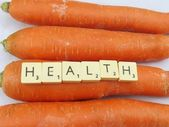 WORD HEALTH AND CARROTS — Stock Photo