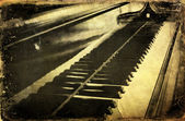 Grunge piano musical background and added paper texture — Stock Photo