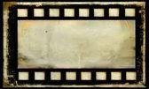 Old grunge film strip frame background — Stock Photo