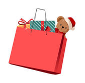 Holiday gifts and teddy bear in shopping bags — Stock Vector