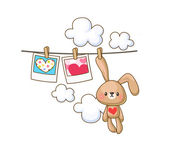 Bunny on the clothesline and photos with hearts — Stock Vector