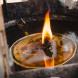 Flames burn in oil burners at buddhist temple — Foto Stock