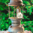 Old broken vintage lantern on the wall — Stock Photo