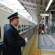 Japanese conductor on the platform — Stock Photo