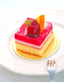 Cheesecake with strawberry and orange — Stock Photo