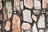 Detail der stein stein muster-wand aus fels — Stockfoto