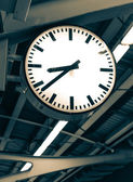 Clock in railway station — Stock Photo