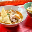 Thai street food traditional Tom Yum noodle soup with pork — Stock Photo