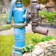 Old retro water pump in garden — Stock Photo