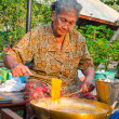The old thai women making kanom foy thong dessert in a brass pan — Stock Photo