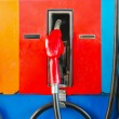 Photo: Colorful fuel oil gasoline dispenser