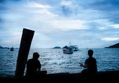 Silhouettes of the boys which are fishing — Stock Photo