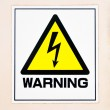 Industry yellow high voltage warning sign on a wall — Stock Photo