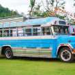 Blue farm bus in countryside — Stock Photo