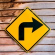Yellow right turning traffic road sign — Foto de Stock