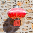 Traditional red chinese lantern hanging on the wall — Foto de Stock