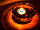 Burning candle light background — Stock Photo
