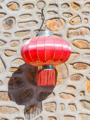 Traditional red chinese lantern hanging on the wall — Stock Photo