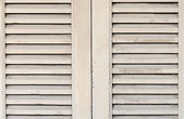 Wooden window with shutters closed — 图库照片