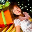Portrait of a beautiful young asian woman standing in front of present gift box with bokeh background — Stock Photo