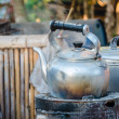 Old kettle on a stove — Stock Photo