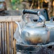 Stock Photo: Old kettle on a stove