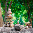 Stacked stones in balanced pile in the forest — Stock Photo