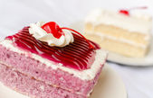 Cake with mousse whipping cream and cherry on top — Stok fotoğraf