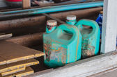 Old dirty green plastic  oil gallon in garage — Stock Photo