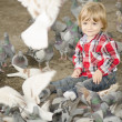 Baby Surrounded by Doves — Stock Photo