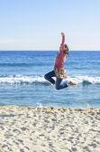 Girl Jumping on Beach — Stock Photo
