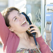 A happy woman talking at phone - Foto Stock