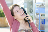 A happy woman talking at phone — Stock Photo