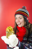 Happy Woman Looking at her Gift — Stock Photo