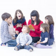 Mother tells a story — Stock Photo #18427583