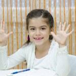 Schoolgirl at her Desk — Stock Photo #20318043