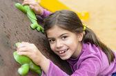 Little Girl on a Climbing Wall — Stock Photo