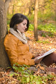 Time for books in the autumn forest — Stock Photo
