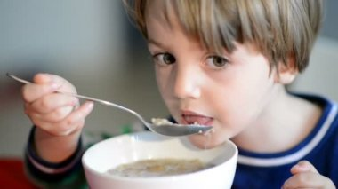 Boy Eating Cereal with Milk — Stock Video
