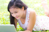 A girl use laptop in the park — Stock Photo