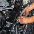 Mechanic repairing engine - Stock Photo