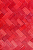 Weave bamboo texture red color — Stock Photo