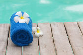 Blue Towel and Flower at the Poolside — Stock Photo