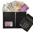 Black purse with dollars and euros, calculator, pen — Stock Photo #12710812