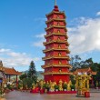 Stock Photo: Red Chinese tower in monastery outside.